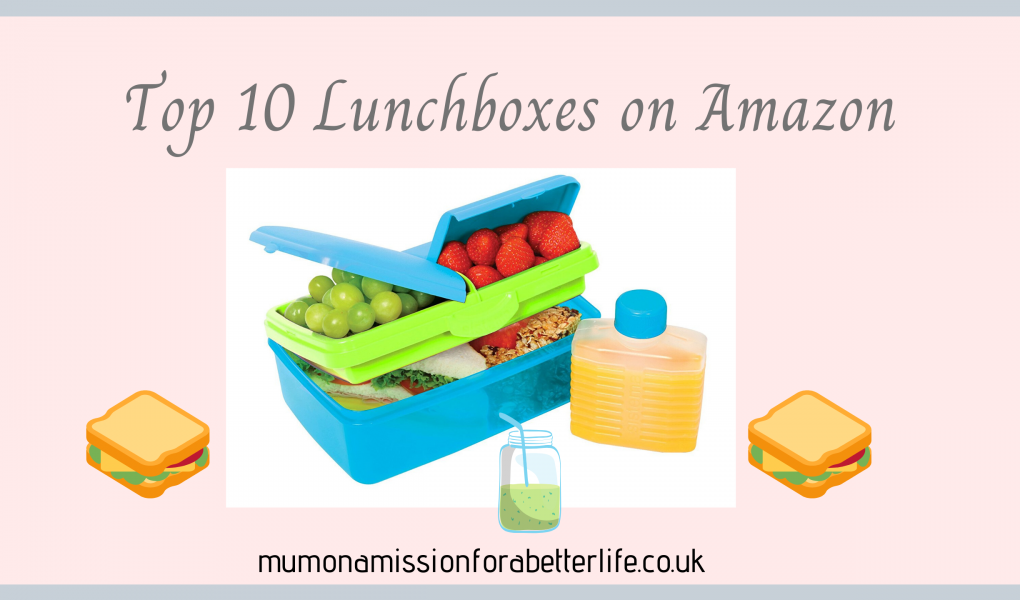 Open lunch box with grapes and strawberries in view and an orange drink in a clear bottle