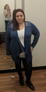 Lady in a changing room modeling blue waterfall cardigan