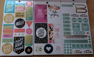 Inside pages of three happy planner sticker pads in a row