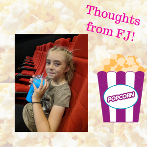 Girl siting in cinema and popcorn