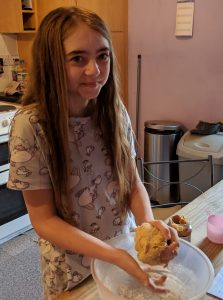 Girl making dough for homemade dog treats