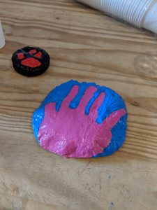 A salt dough painted hand print