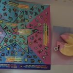 A paper guide of collectable charms and a lucky fortune toy