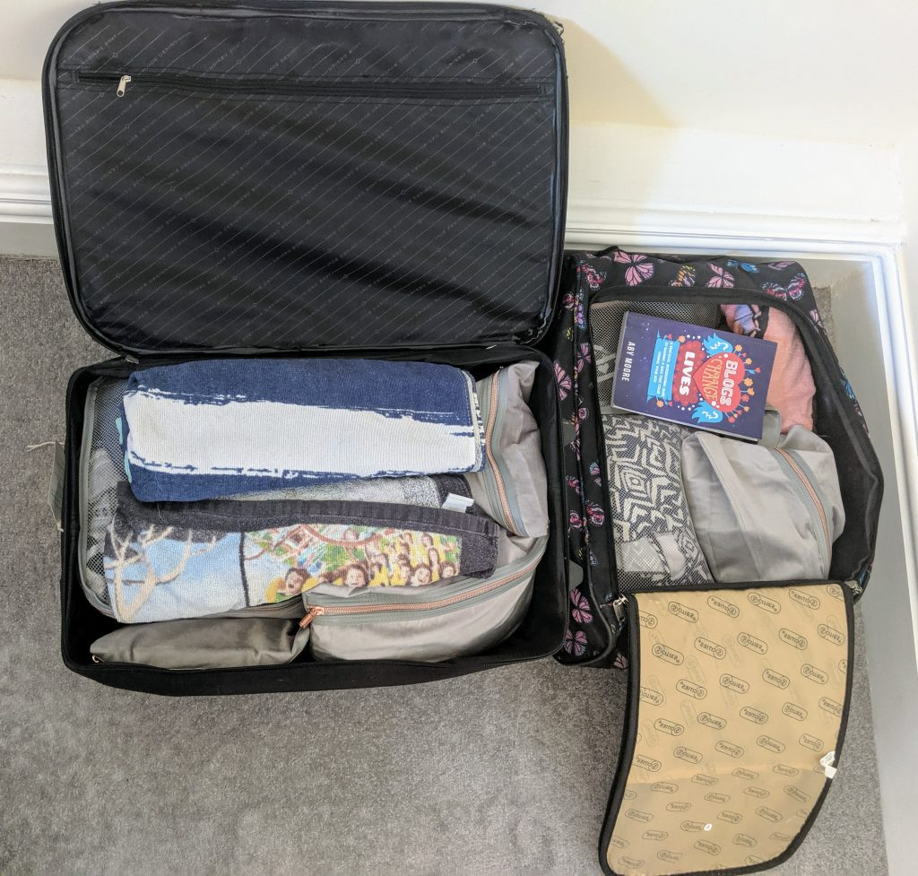 Two open suitcases showing how all items are packed inside