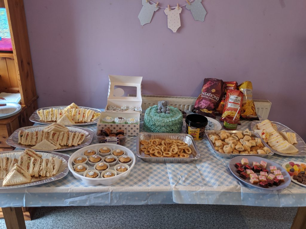 Table full of cold buffet food for a baby shower