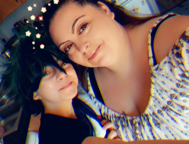 Mother and daughter selfie using a snap chat filter of stars