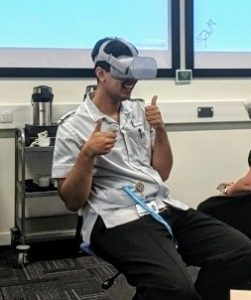 Adult nurse demonstrating the VR headset at ARU at my first press trip