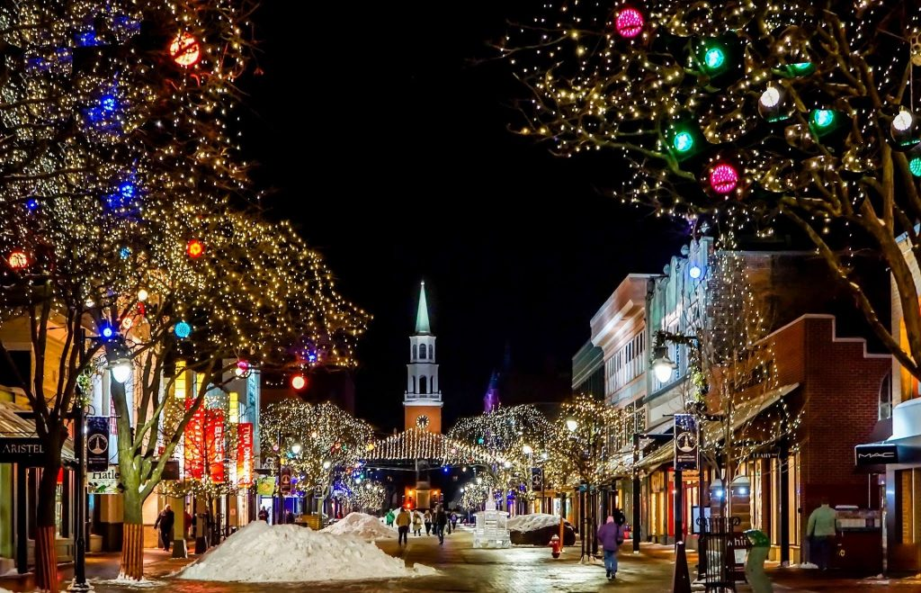 A street lit up with christmas lights