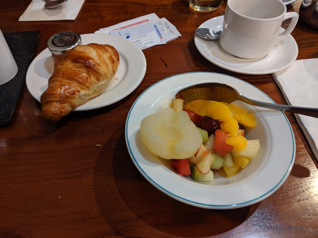 Croissant and bowl of fruit at a blogging conference