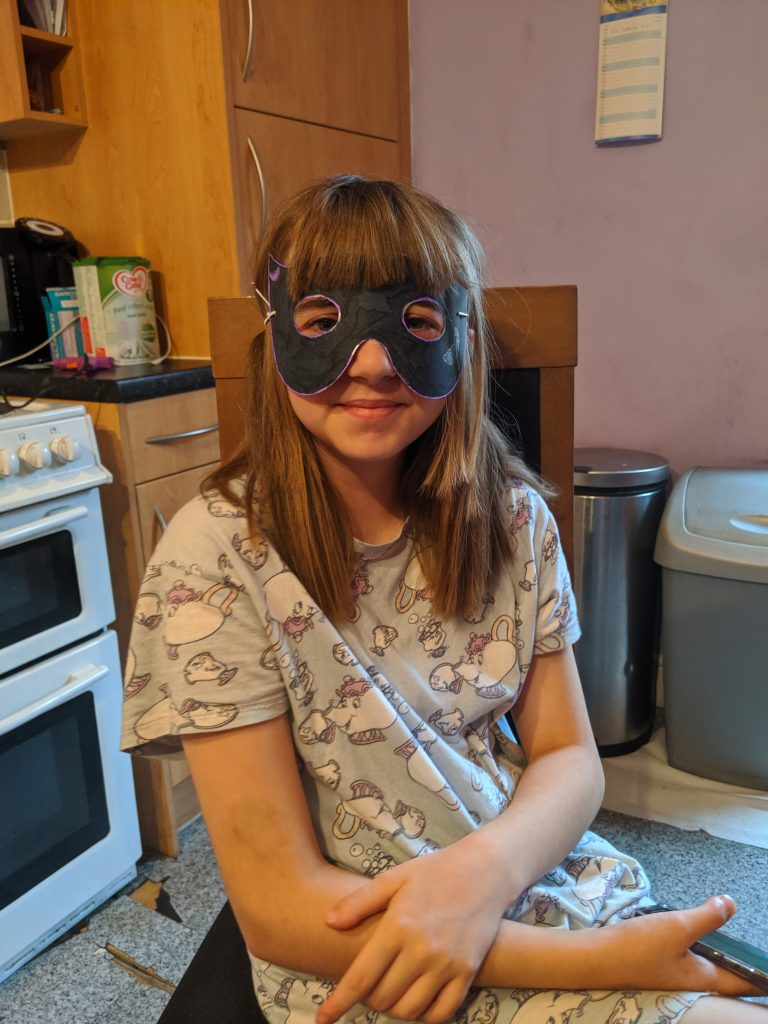 Girl wearing a homemade Halloween mask