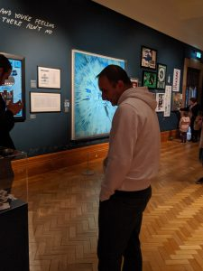 Darren looking at the Ed Sheeran exhibit