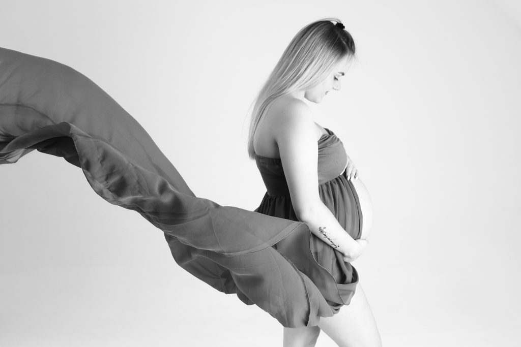 Pregnant Chloe in a flowing dress in black and white
