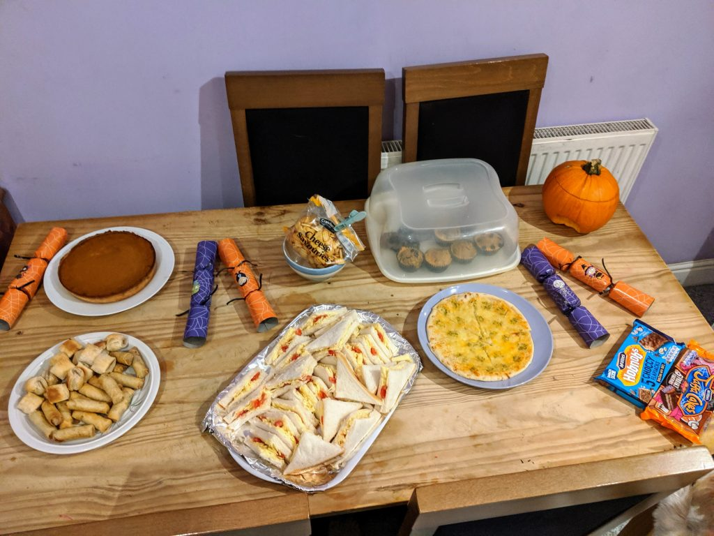 Table full of food for a Halloween party