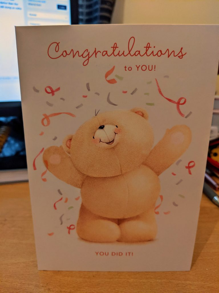 Congratulations card with a teddy bear on the front
