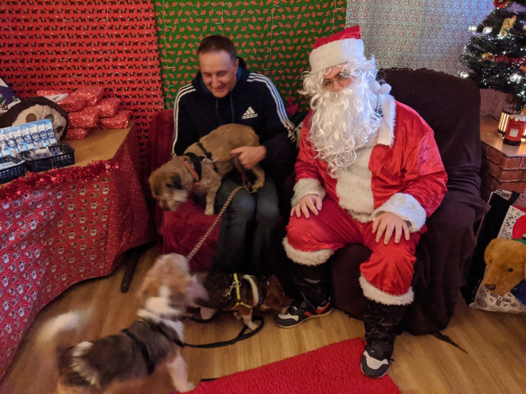 Santa with Darren and the three dogs