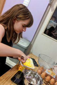 Faith measuring the butter