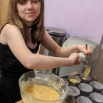 Faith putting the cake batter into the cupcake cases