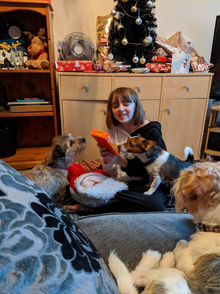 Faith opening presents with the dogs