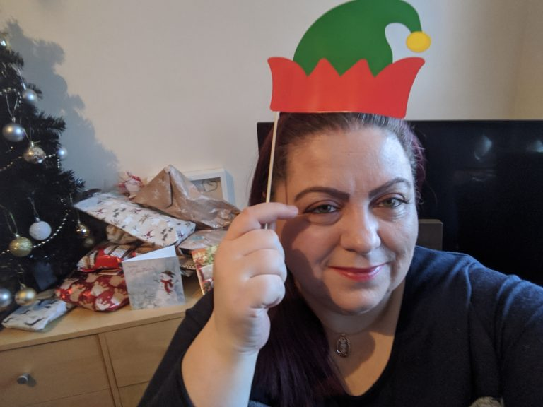 me with a selfie prop elf hat!