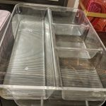 Clear plastic tray with four compartments