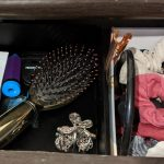Hair brush, hair bands and clips in desk drawer