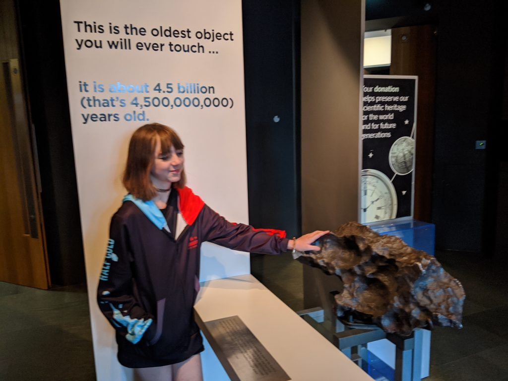 Faith touching a meterite which is 4.5 billion years old!