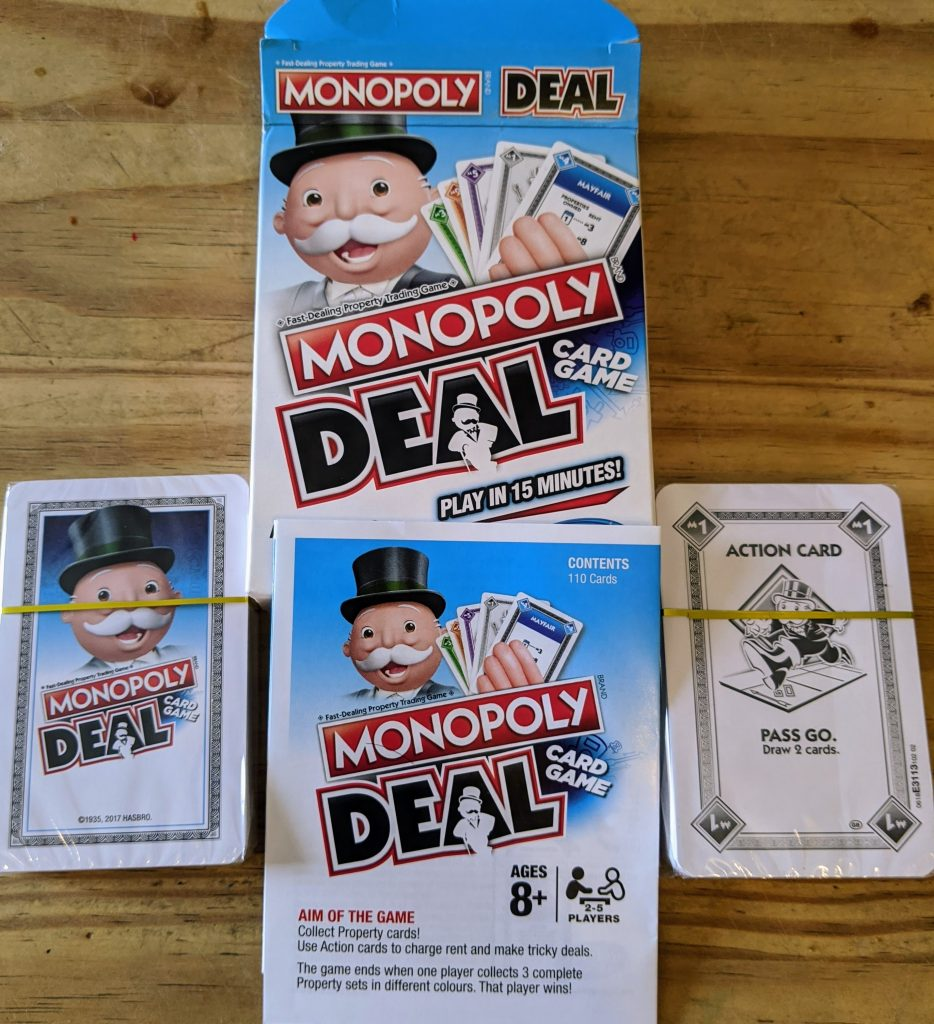 Box and contents of monopoly deal