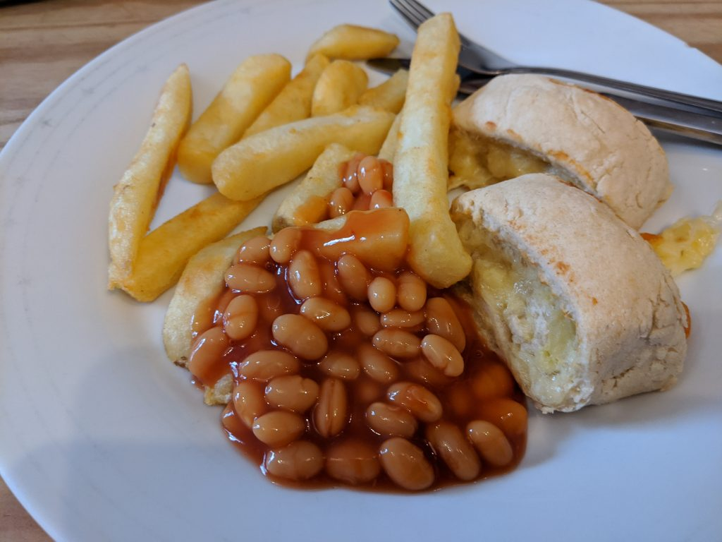 Cheese and potato swirls with chips and beans
