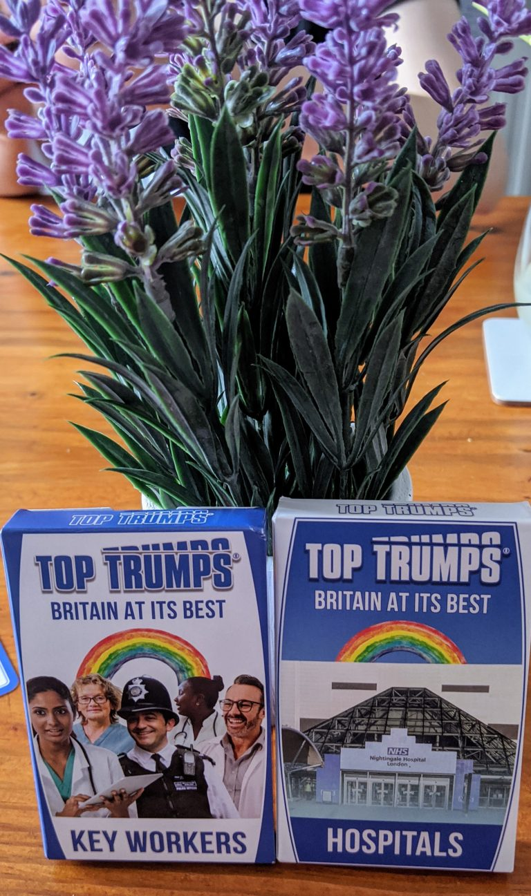 twp packs of top trumps cards in front of a plant