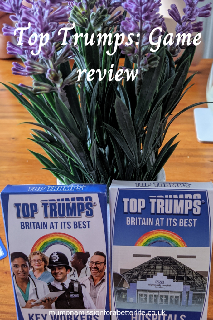 Britain at its best top trumps game packs in front of some flowers on a table.