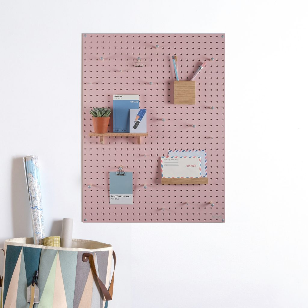 Pastel pink peg board to utilise space