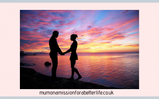 Silhouette of man and woman in love at the beach at sunset