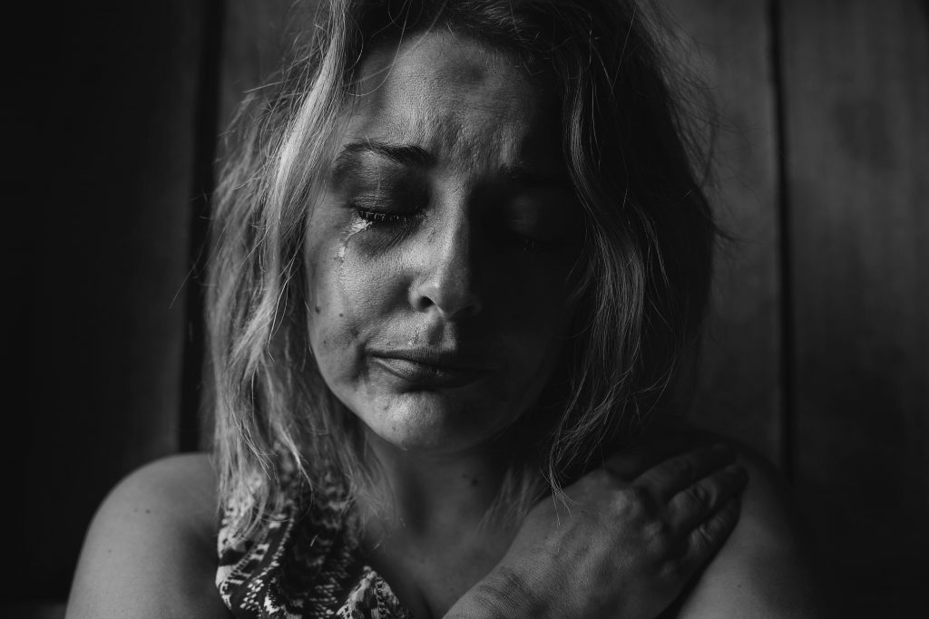 Woman crying, black and white photo