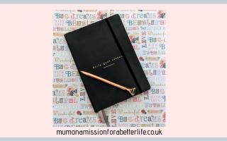 Goal setter planner with rose gold crystal ended pen