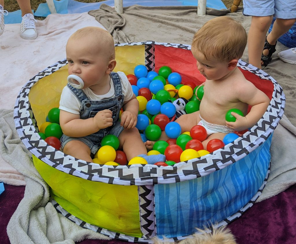 Keaton and Aaron, cousins playing together in ball pit