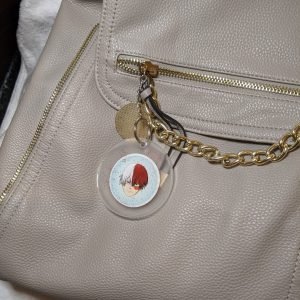 MHA resin keyring attached to a backpack