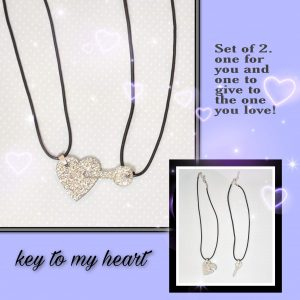 Two Black cord necklaces with silver glitter heart and key pendants