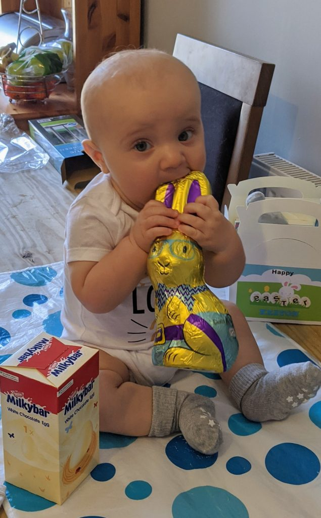 Easter 2020 - baby boy holding a wrapped chocolate bunny
