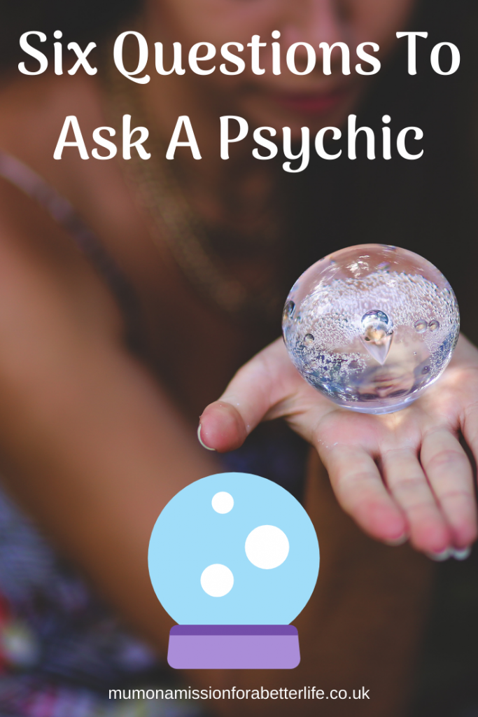 Woman with her hand out and a crystal ball is on her palm