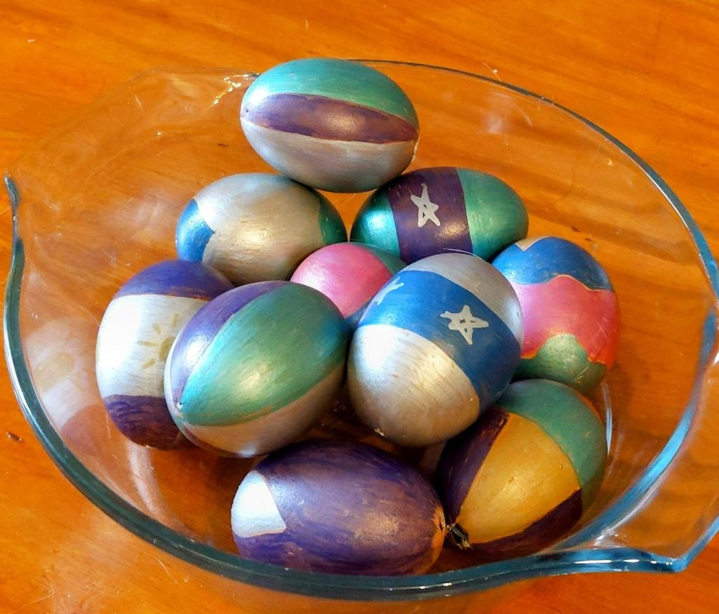 Glass bowl of fortune eggs for Easter