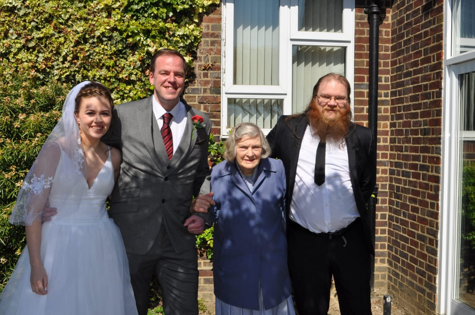 Bride and groom with two wedding guests.