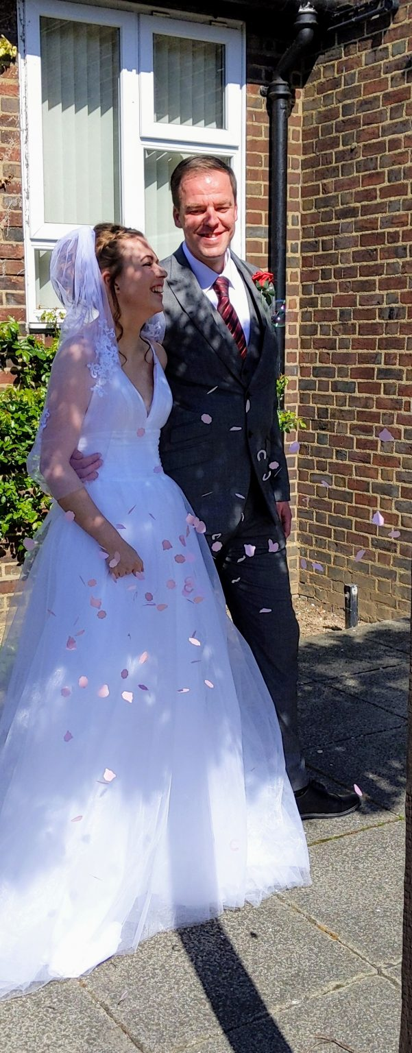 Bride and groom with confetti falling at a COVID wedding
