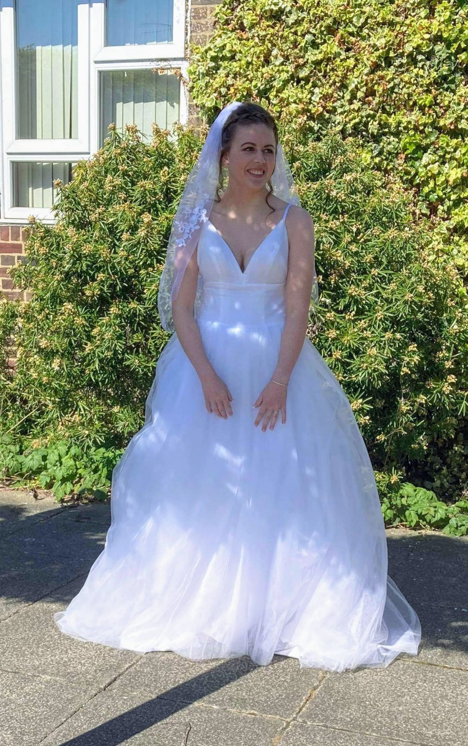 Young woman in her wedding dress about to get married at a COVID wedding