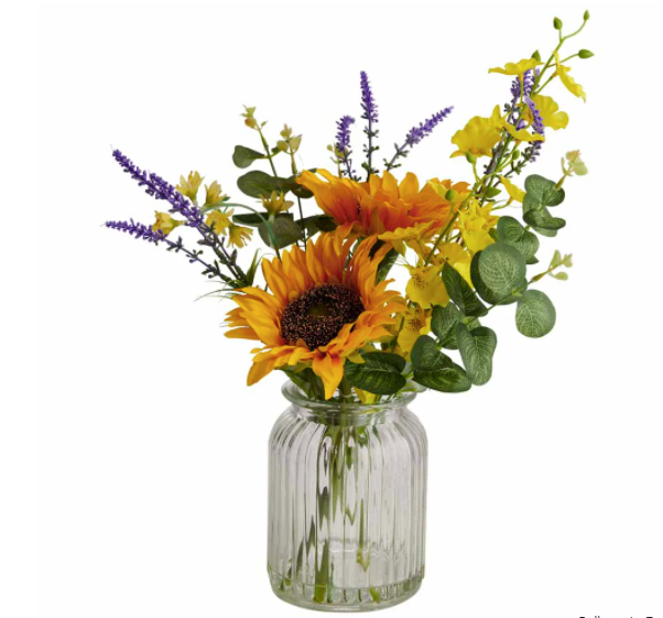 Sunflowers and other floral fake leaves in a glass vase