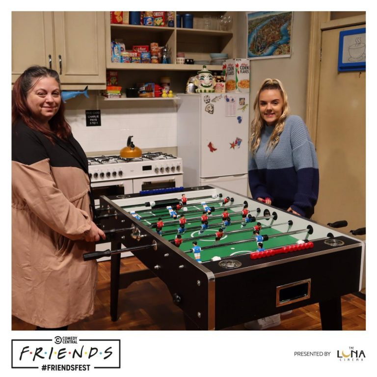 Mother and daughter in Joey and Chandlers apartment kitchen at Friendsfest