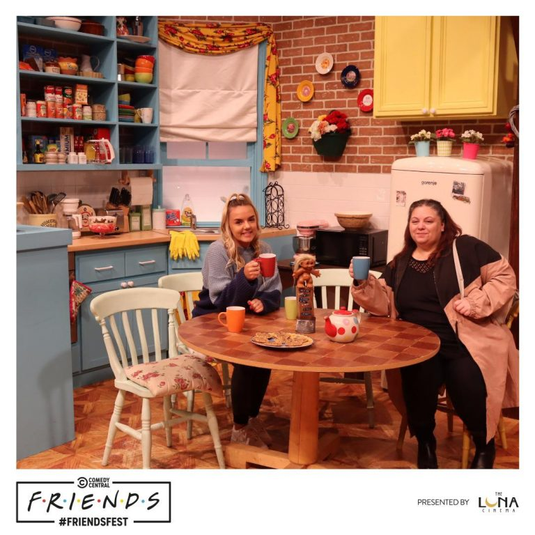 Mother and daughter sitting in Monica's kitchen at Friendsfest