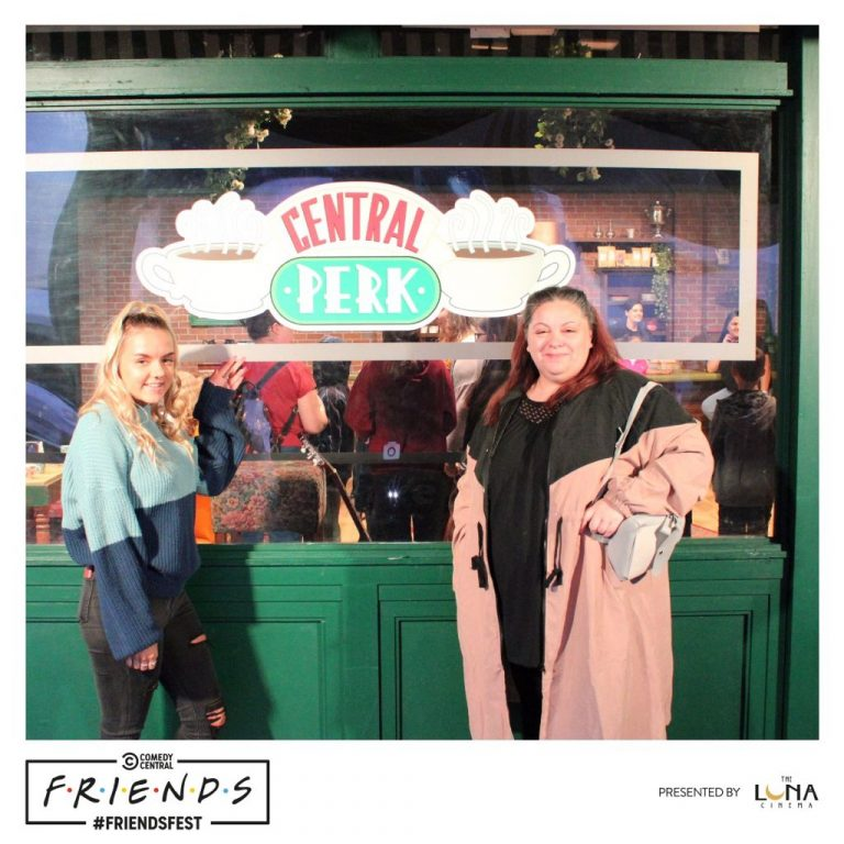 Mother and daughter outside central perk at Friendsfest